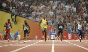 Слева на право:Netherlands Antilles' Churandy Martina, Zimbabwe's Brian Dzingai, Jamaica's Usain Bolt, Wallace Spearmon of the US and Britain's Christian Malcolm во время финального забега среди мужчин на 200 метров во время Олимпийских Игр в Пекине. 20 августа 2008 год. Olivier Morin/AFP